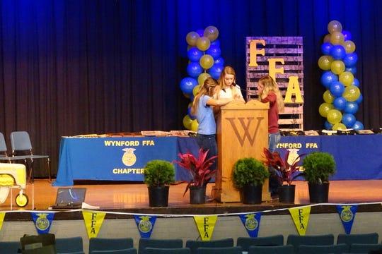 Wynford High School students prepare for the school's annual FFA banquet in the school auditorium, which will be renovated as part of the building program.