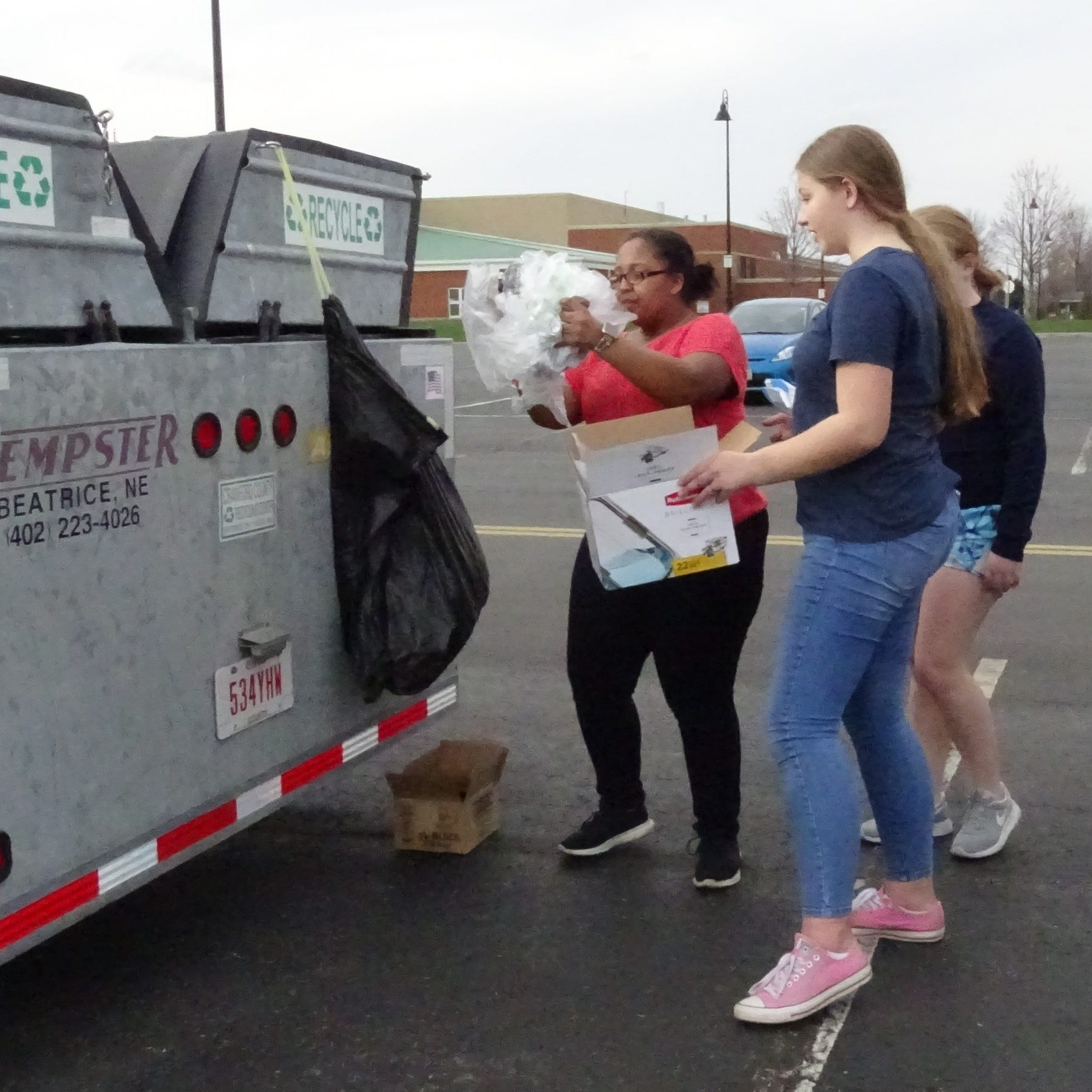At recycling drop-off site, volunteers are ready to help
