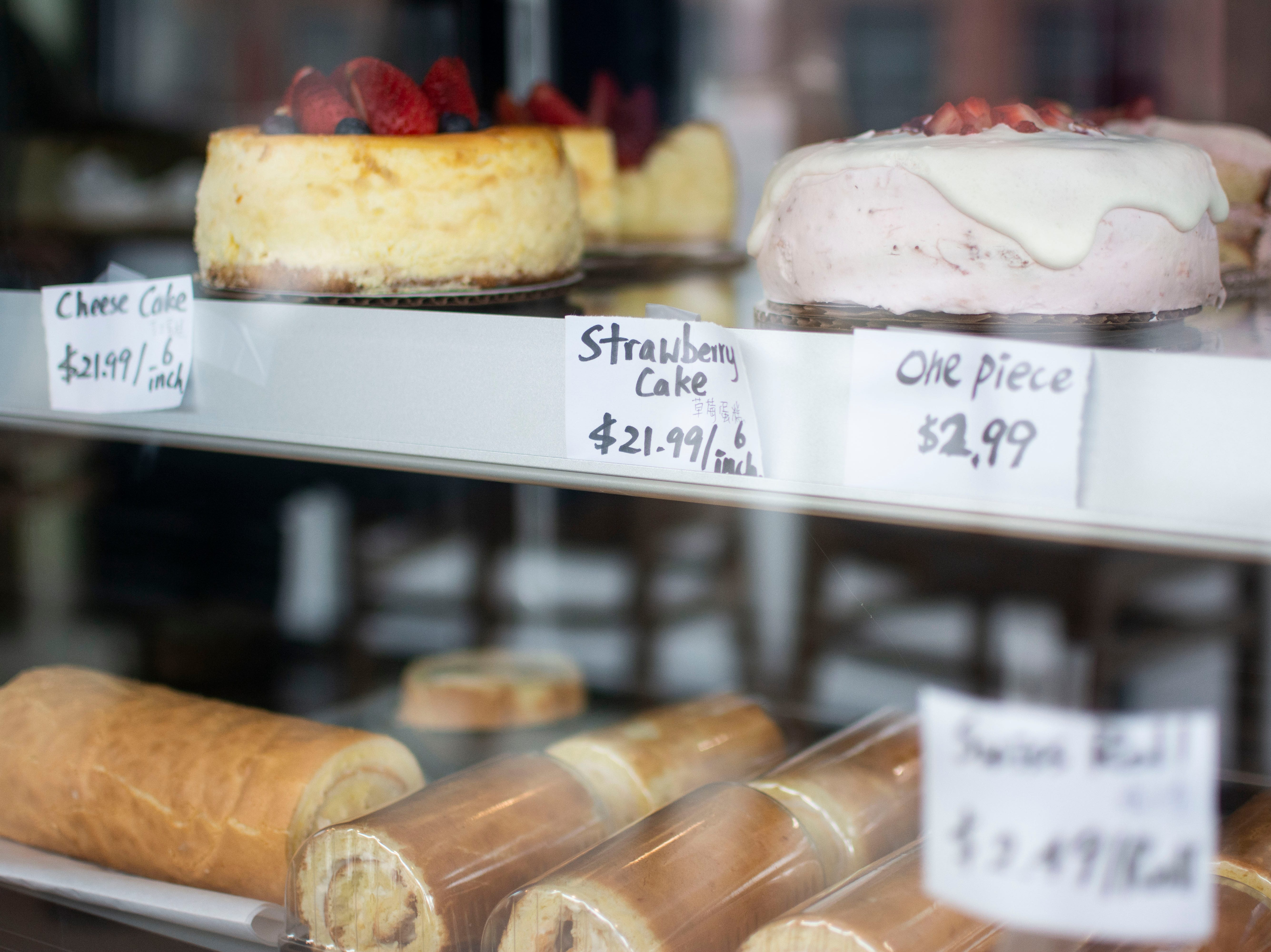 """The cakes at Morning Light bakery are """"Asian sweet, not American sweet,"""" said Ken Liu, the owner's son. They're made with fresh fruit and are less intense."""