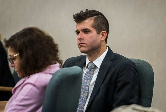Michael McNeil, 29, listens to a statement from mother of a teenage girl that he sexually exploited his youth group when he was a youth pastor at Christ Memorial Church in Williston. McNeil pleaded guilty to the charge in Vermont Superior Court in Burlington on Friday morning, April 12, 2019.