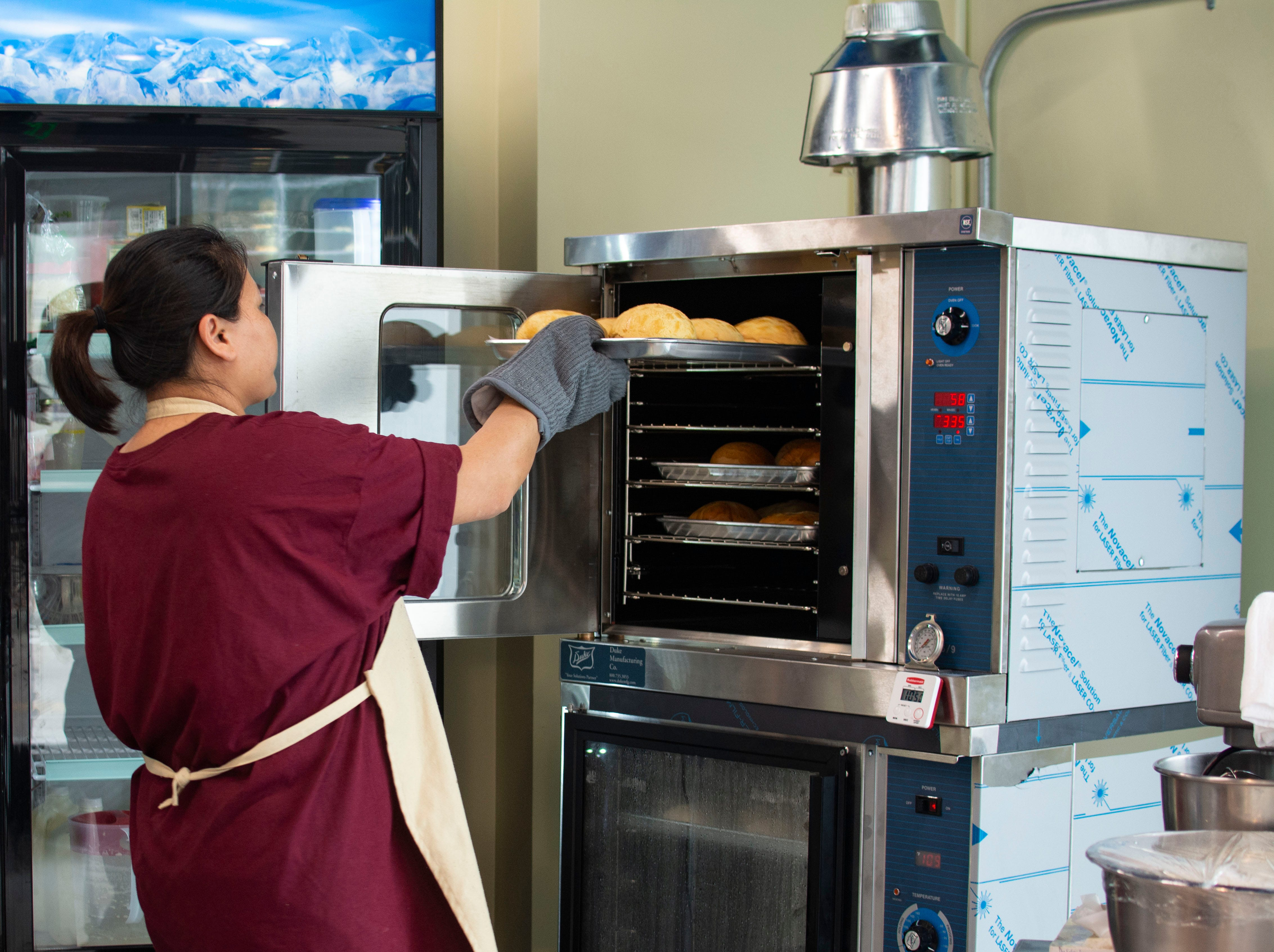 Lai Na Wong bakes fresh buns to keep up with the stream of customers on April 12, 2019