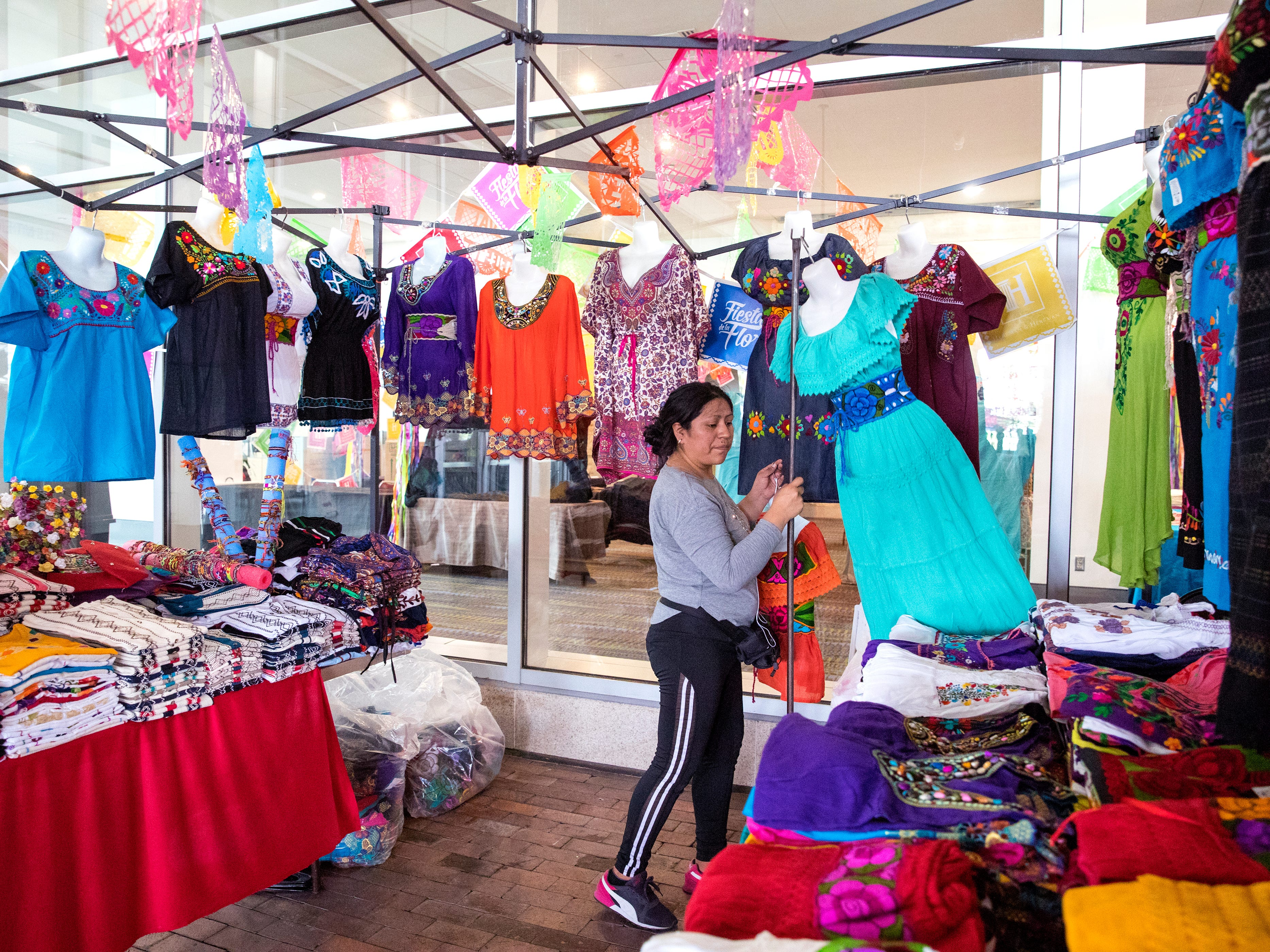 Tarina Diaz sets up her booth in The Mercado in the American Bank Center before Fiesta de la Flor opens on Friday, April 12, 2019. The festival is in honor of the late Tejano singer Selena Quintanilla-Perez. The two-day music event is held in Corpus Christi, Texas.