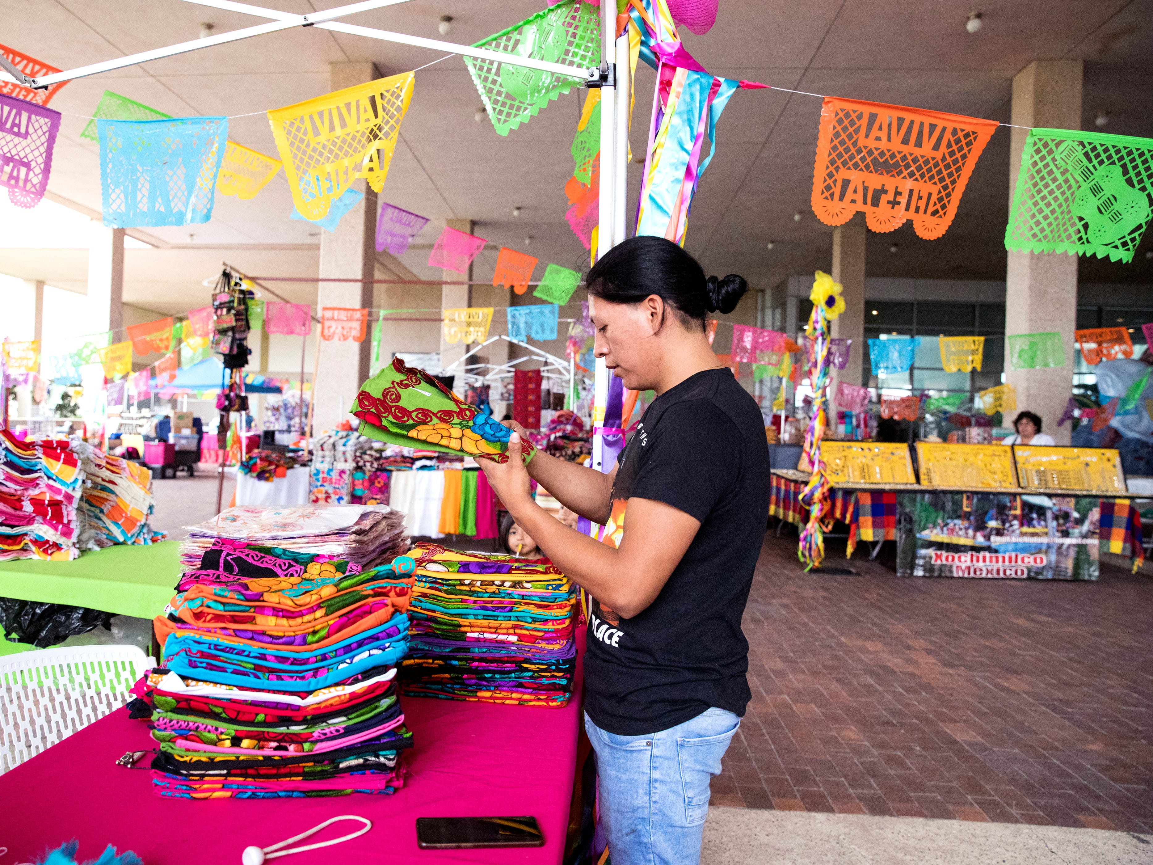 Michael Santian sets up his booth in The Mercado in the American Bank Center before Fiesta de la Flor opens on Friday, April 12, 2019. The festival is in honor of the late Tejano singer Selena Quintanilla-Perez. The two-day music event is held in Corpus Christi, Texas.