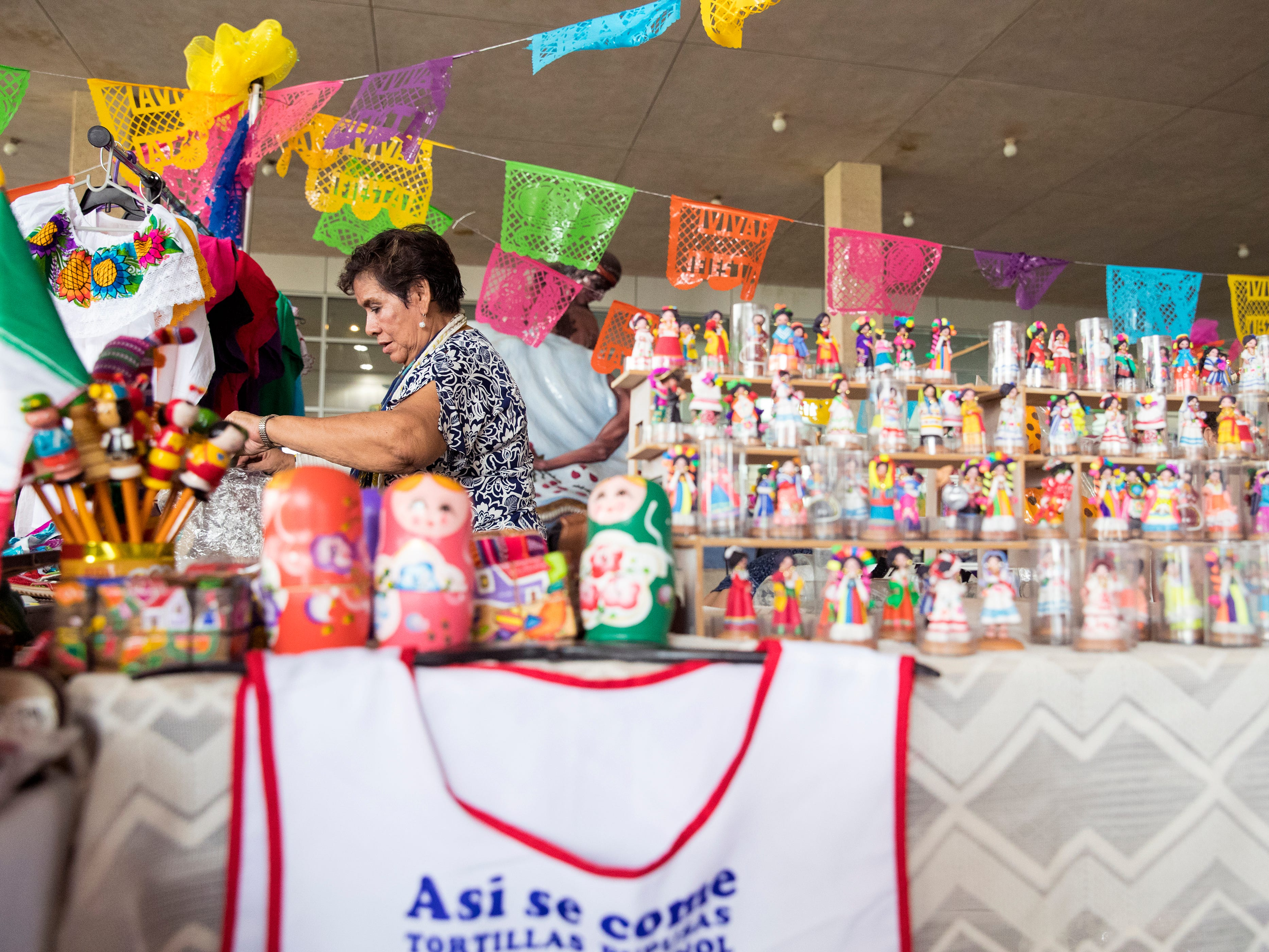 Magdalena Martinez sets up her booth in The Mercado in the American Bank Center before Fiesta de la Flor opens on Friday, April 12, 2019. The festival is in honor of the late Tejano singer Selena Quintanilla-Perez. The two-day music event is held in Corpus Christi, Texas.