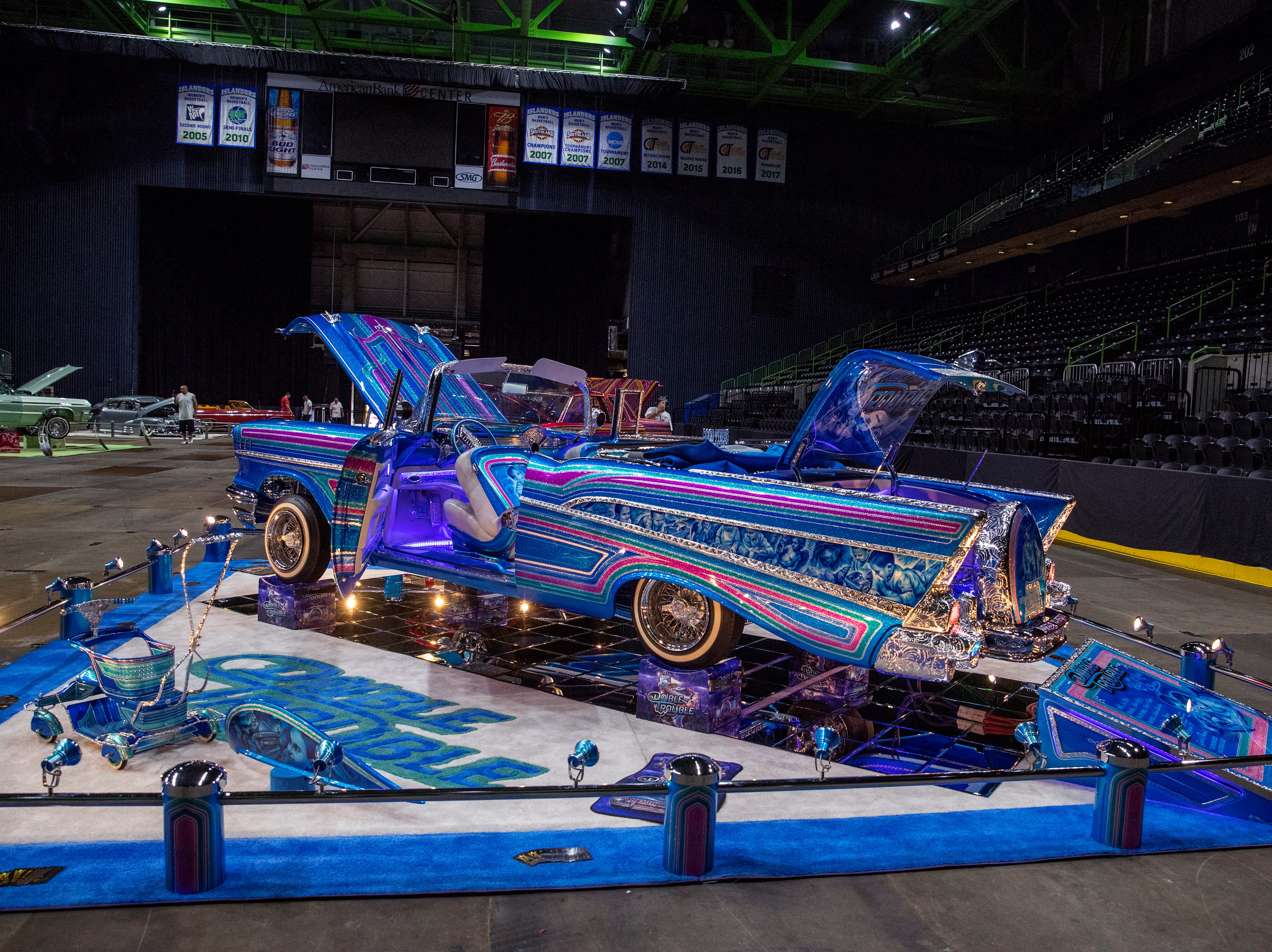 Low riders like this one on display inside the American Bank Center before the start of Fiesta de la Flor on Friday, April 12, 2019, in Corpus Christi, Texas.