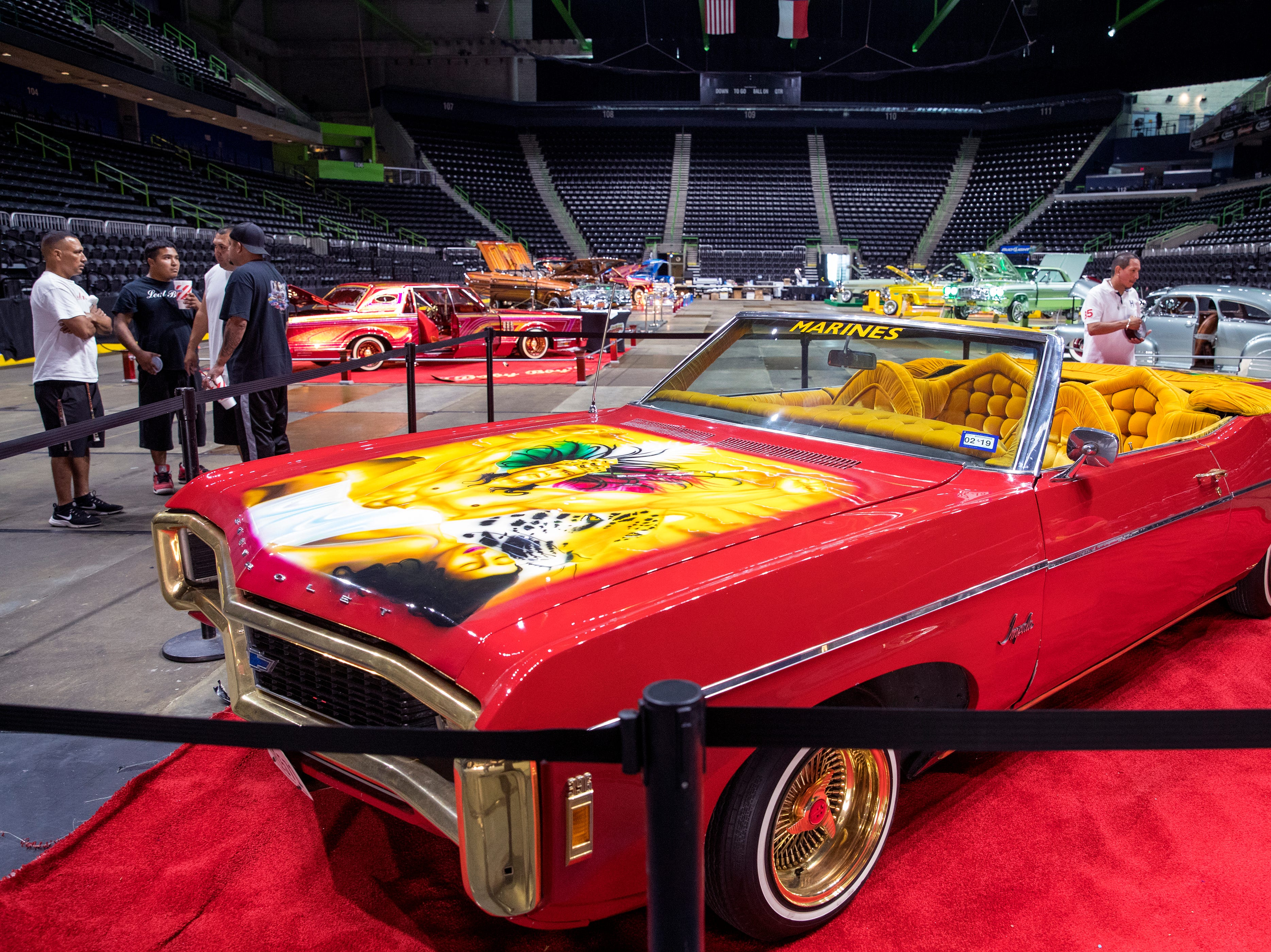 """Low riders like this one featured in the film """"Selena"""" on display inside the American Bank Center before the start of Fiesta de la Flor on Friday, April 12, 2019, in Corpus Christi, Texas."""