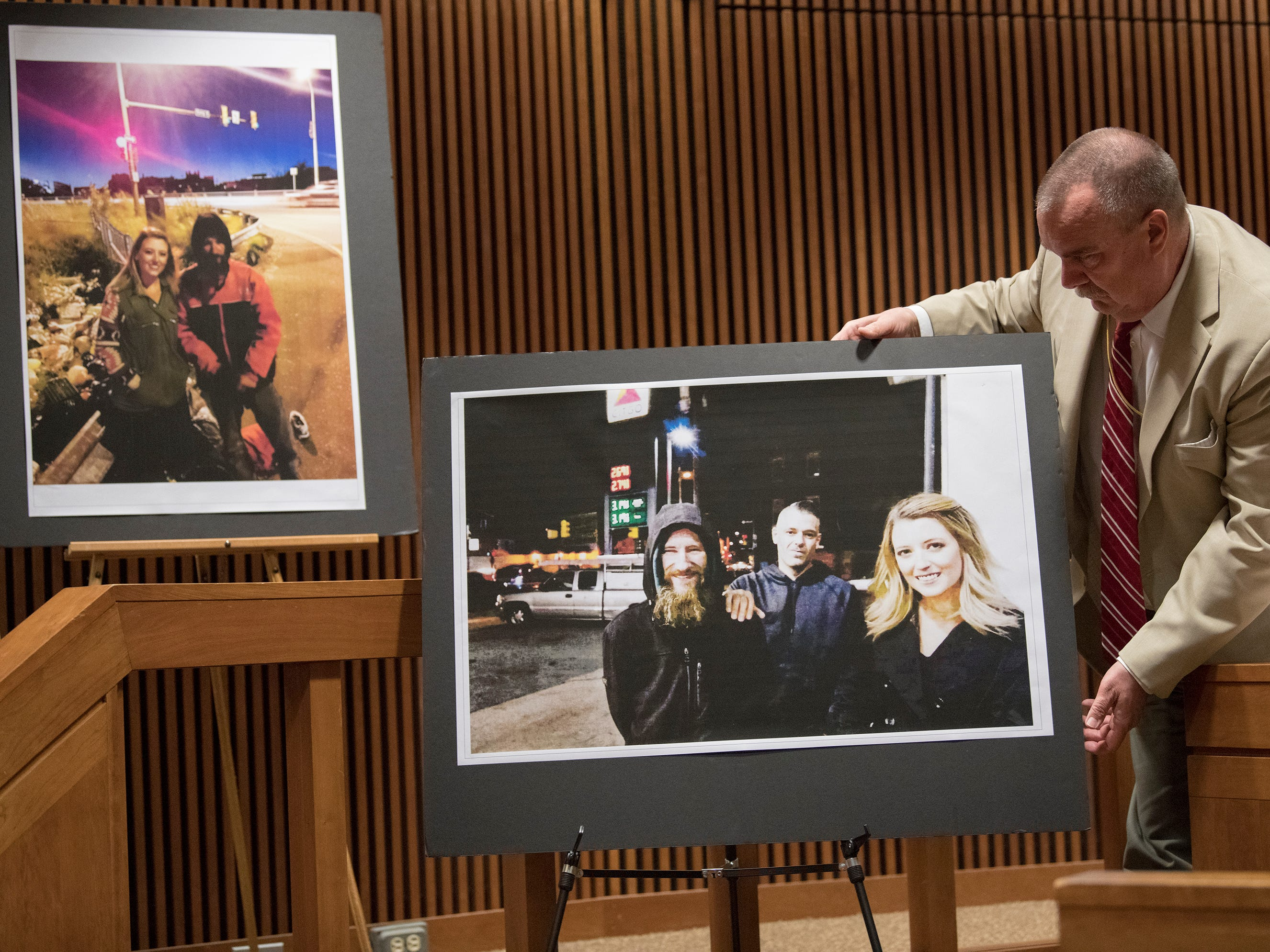 Photos of Johnny Bobbitt Jr., pictured with Burlington County residents Mark D'Amico and Katelyn McClure,  are displayed in a Burlington County Superior Court courtroom as Bobbitt is sentenced on the charge of conspiracy to commit theft by deception on Friday, April 12, 2019.  Bobbitt received a 5-year Drug Court probationary term, including long-term in-patient treatment, for his role in a GoFundMe scam.