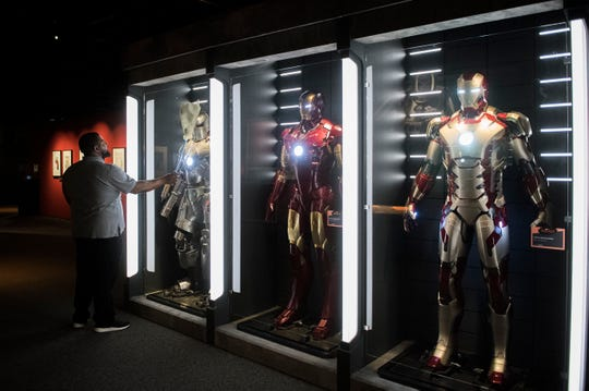 Jason Simmons of ABM commercial cleaners dusts off an Iron Man exhibit at the new 'Marvel: Universe of Super Heroes' installation at the Franklin Institute Friday, April 12, 2019 in Philadelphia, Pa. The exhibit runs from April 13-September 2.