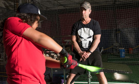 """Rob """"Pottsy"""" Potts, a former batting practice pitcher for the Philadelphia Phillies, who has become one of the most respected instructors in South Jersey, instructs Eddie Pineiro, 9 of Cherry Hill,  at Ambush Baseball in Cherry Hill."""