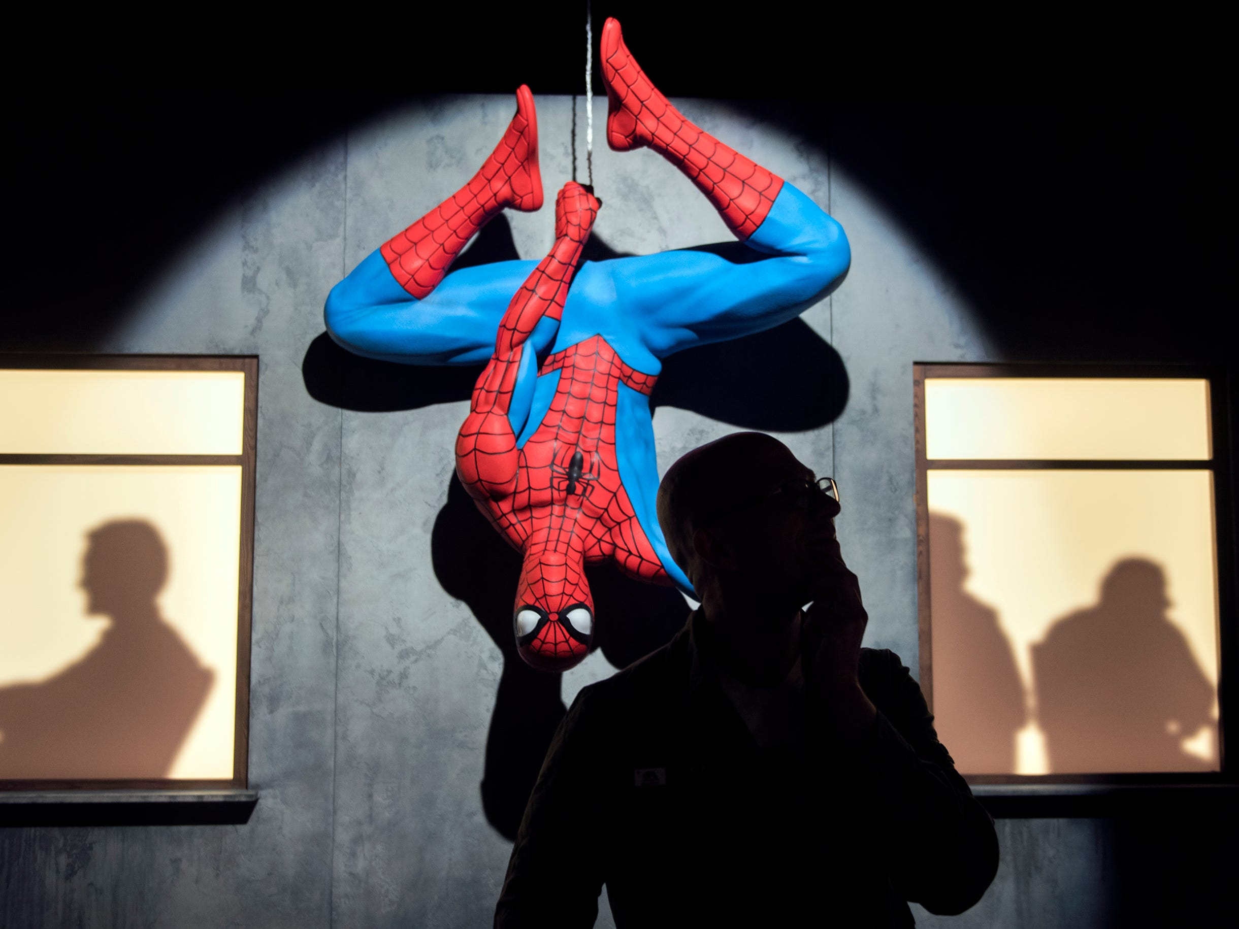 Spider-Man looms behind Asbury Park Press reporter Alex Biese at the new 'Marvel: Universe of Super Heroes' installation at the Franklin Institute Friday, April 12, 2019 in Philadelphia, Pa. The exhibit runs from April 13-September 2.