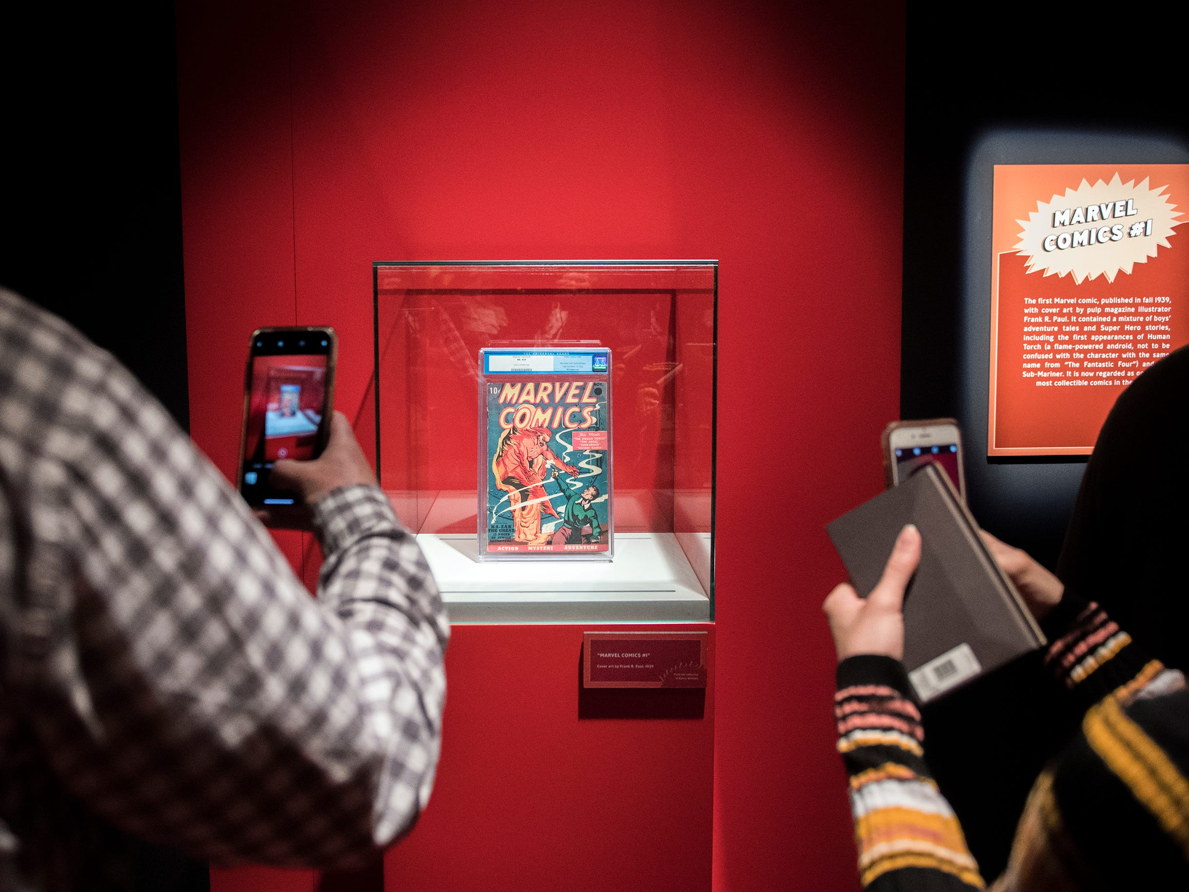 Guests photograph a rare copy of the first ever Marvel comic at the new 'Marvel: Universe of Super Heroes' installation at the Franklin Institute Friday, April 12, 2019 in Philadelphia, Pa. The exhibit runs from April 13-September 2.
