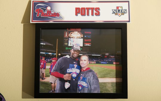 "A photograph of Rob ""Pottsy"" Potts, a former batting practice pitcher for the Philadelphia Phillies, and Ryan Howard hangs in Potts' Mount Laurel home.  Potts used the lessons he learned with the Phillies to build a baseball instruction business and become one of the most respected instructors in South Jersey."