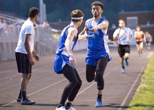 Junior Courtland Duncan hands off to freshman Xzavier Doss during the 4x400 meter run on Thursday, April 11, 2019, at Paint Valley High School with the Chillicothe men's team placing second overall.