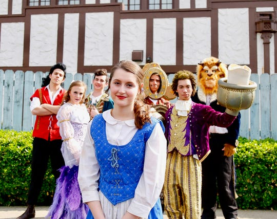 "The cast of ""Disney's Beauty and the Beast"" at AHS includes Senior Adam Radcliffe as Gaston, Senior Jordan Slemons as Babette, Junior Jacob Gildenblatt as LeFou, Senior Alexis Zoglio as Belle, Junior Ian Baker as Cogsworth, Junior Nate Goodlett as Lumiere, and Senior Austin Bally as the Beast. Photo by Jennifer Alessandrini."