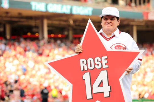 Reds great Pete Rose holds a star bearing his name before a Reds-Padres game at GABP in June of 2016.