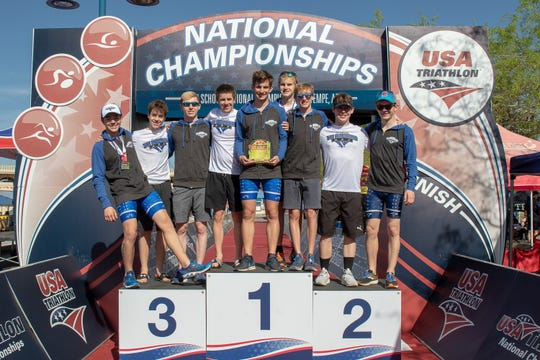 From left: St. Xavier's national champion triathlon team members are Alex Baier, Liam Dwyer, Christian Wall (captain,) Ted Lockett, Christopher Langenderfer (captain,) Sam Hinnenkamp, Sam Beutel, Caleb Schmidt and Nate Baier (captain).