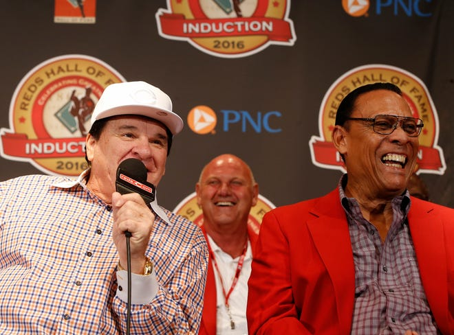 Cincinnati Reds great and 2016 Hall of Famer Pete Rose, left, smiles with former teammate Tony Perez during a press conference before the MLB game between the San Diego Padres and Cincinnati Reds, Saturday, June 25, 2016, at Great American Ball Park in Cincinnati.