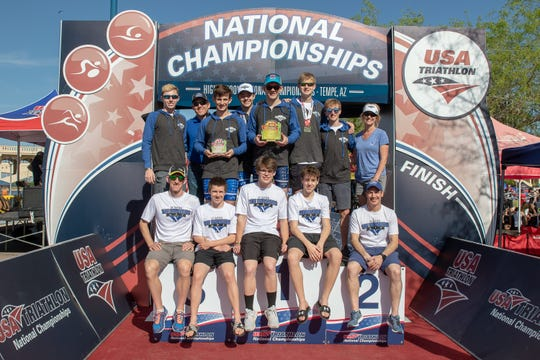 Members of the St. Xavier national champion triathlon team are, from left, Christian Wall, Ed Baier, Christopher Langenderfer, Alex Baier, Nate Baier, Sam Hinnenkamp, Sam Beutel, Rachel Langenderfer; seated, from left: Colin Riley, Ted Lockett, Caleb Schmidt, Liam Dwyer and Jim Murphy.