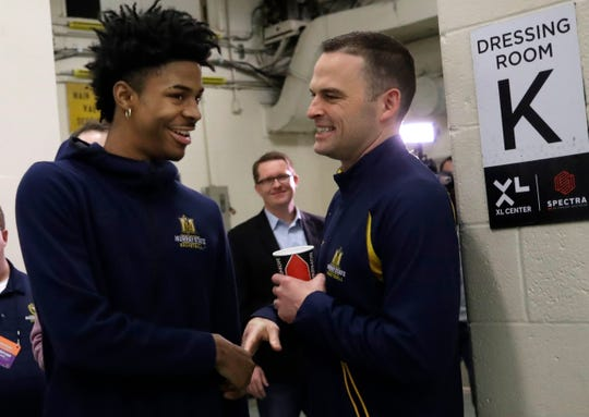 Murray State coach Matt McMahon, right, greets Ja Morant after a news conference at the NCAA Tournament in March in Hartford, Conn.