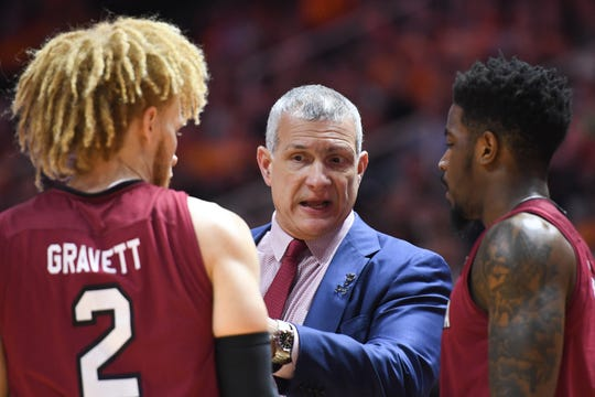 Feb 13, 2019: South Carolina Gamecocks head coach Frank Martin speaks with guard Hassani Gravett (2) during the first half against the South Carolina Gamecocks at Thompson-Boling Arena.