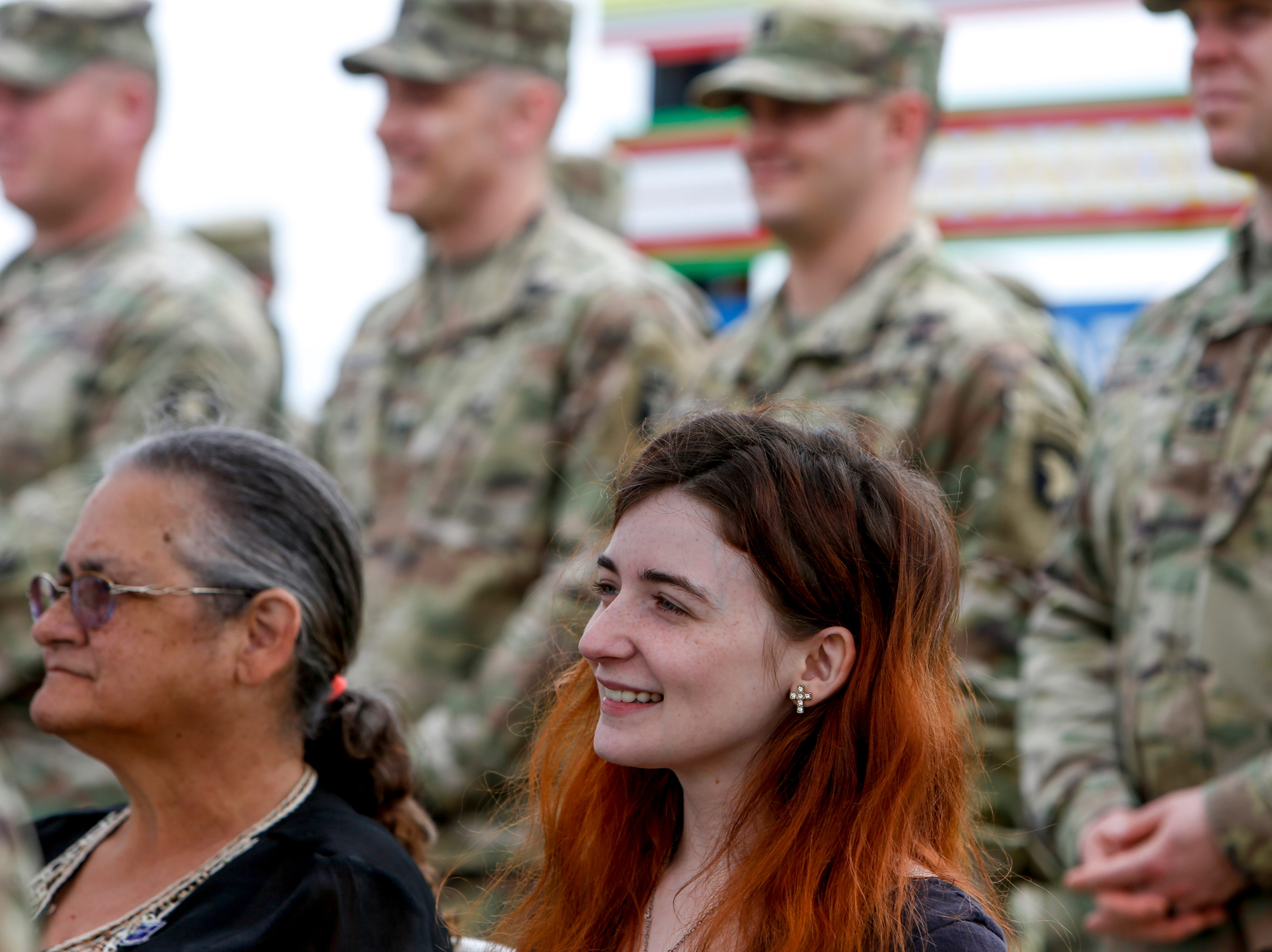 Rhia Gallo smiles while listening to officers speak during a colors casing ceremony prior to deployment for Ukraine at 2 BCT Headquarters in Fort Campbell, KY., on Friday, April 12, 2019.