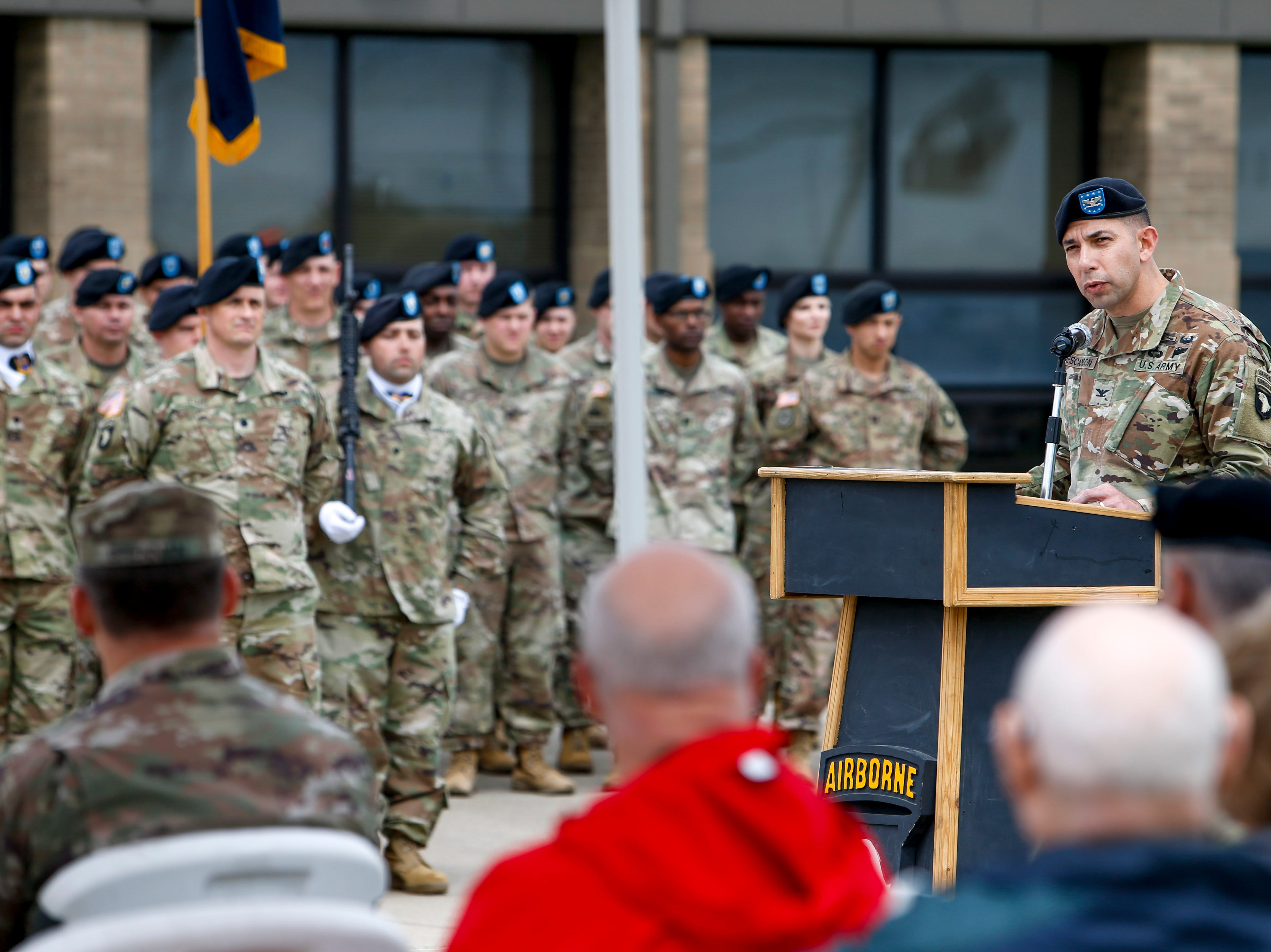 Col. Joseph Escandon speaks at a podium during a colors casing ceremony prior to deployment for Ukraine at 2 BCT Headquarters in Fort Campbell, KY., on Friday, April 12, 2019.
