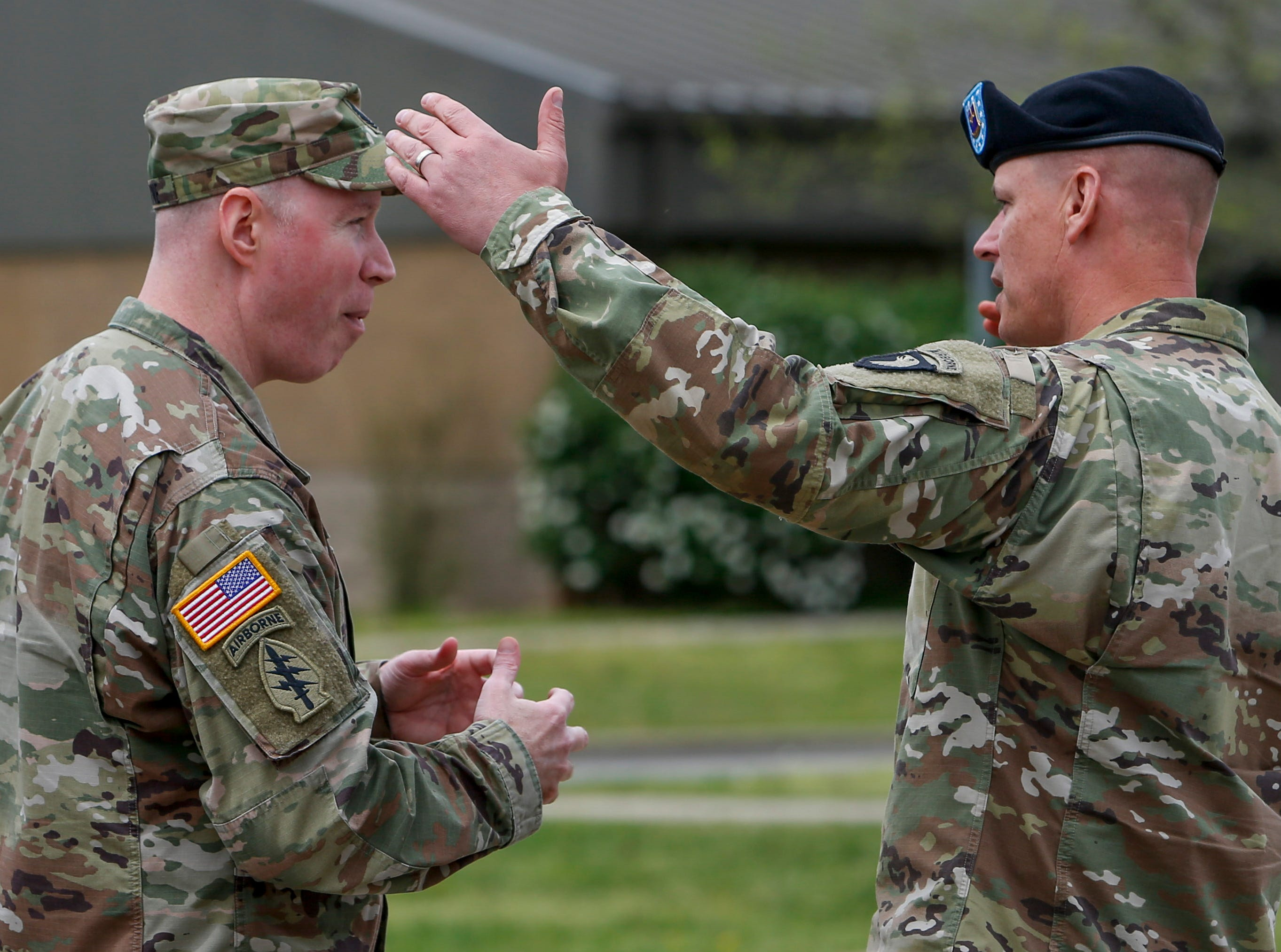 Senior non-commissioned officers speak with one another before a colors casing ceremony prior to deployment for Ukraine at 2 BCT Headquarters in Fort Campbell, KY., on Friday, April 12, 2019.