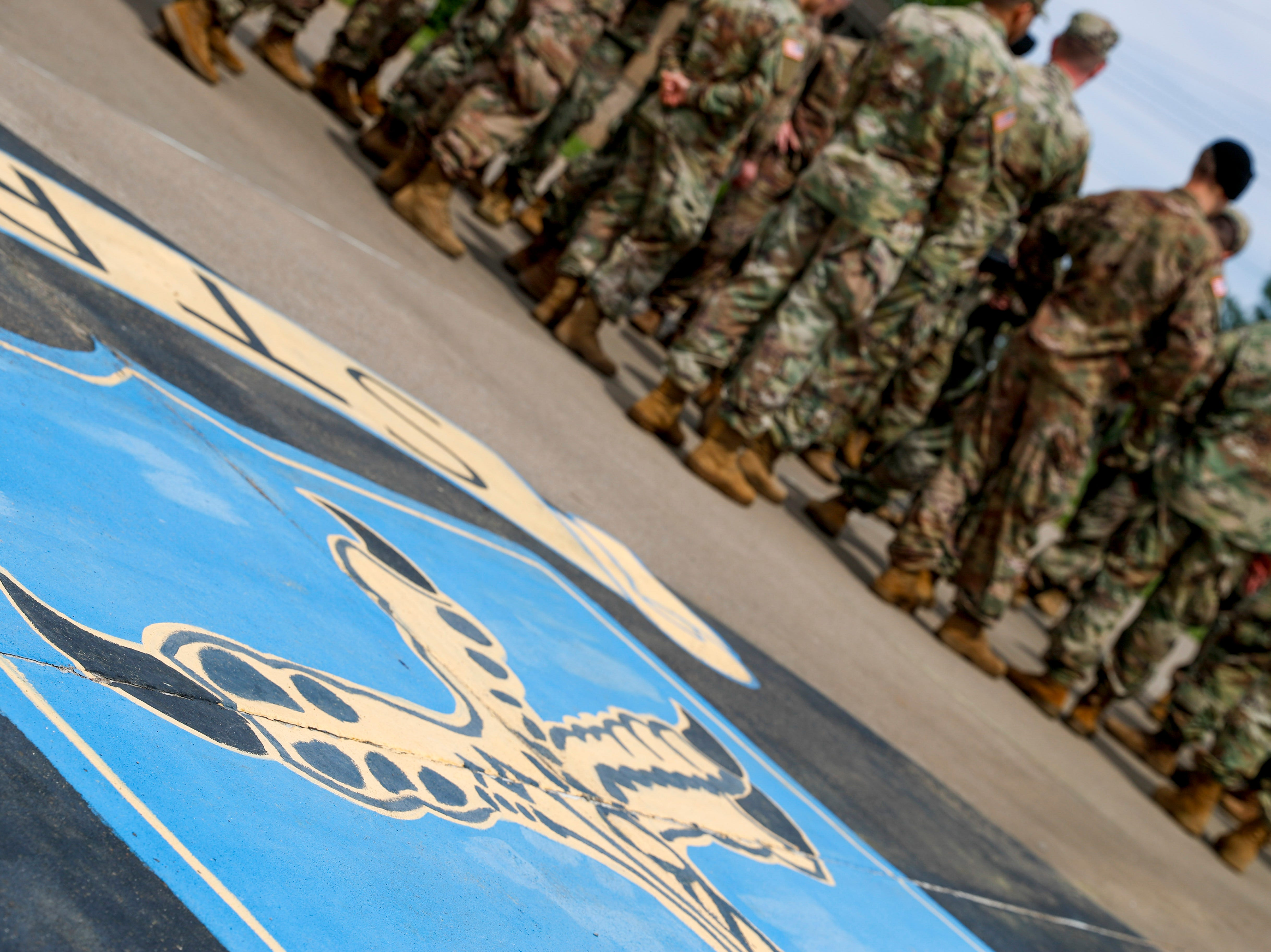 "The ""Strike"" insignia can be seen in the foreground while soldiers listen for their names to be called and dismissed after a colors casing ceremony prior to deployment for Ukraine at 2 BCT Headquarters in Fort Campbell, KY., on Friday, April 12, 2019."