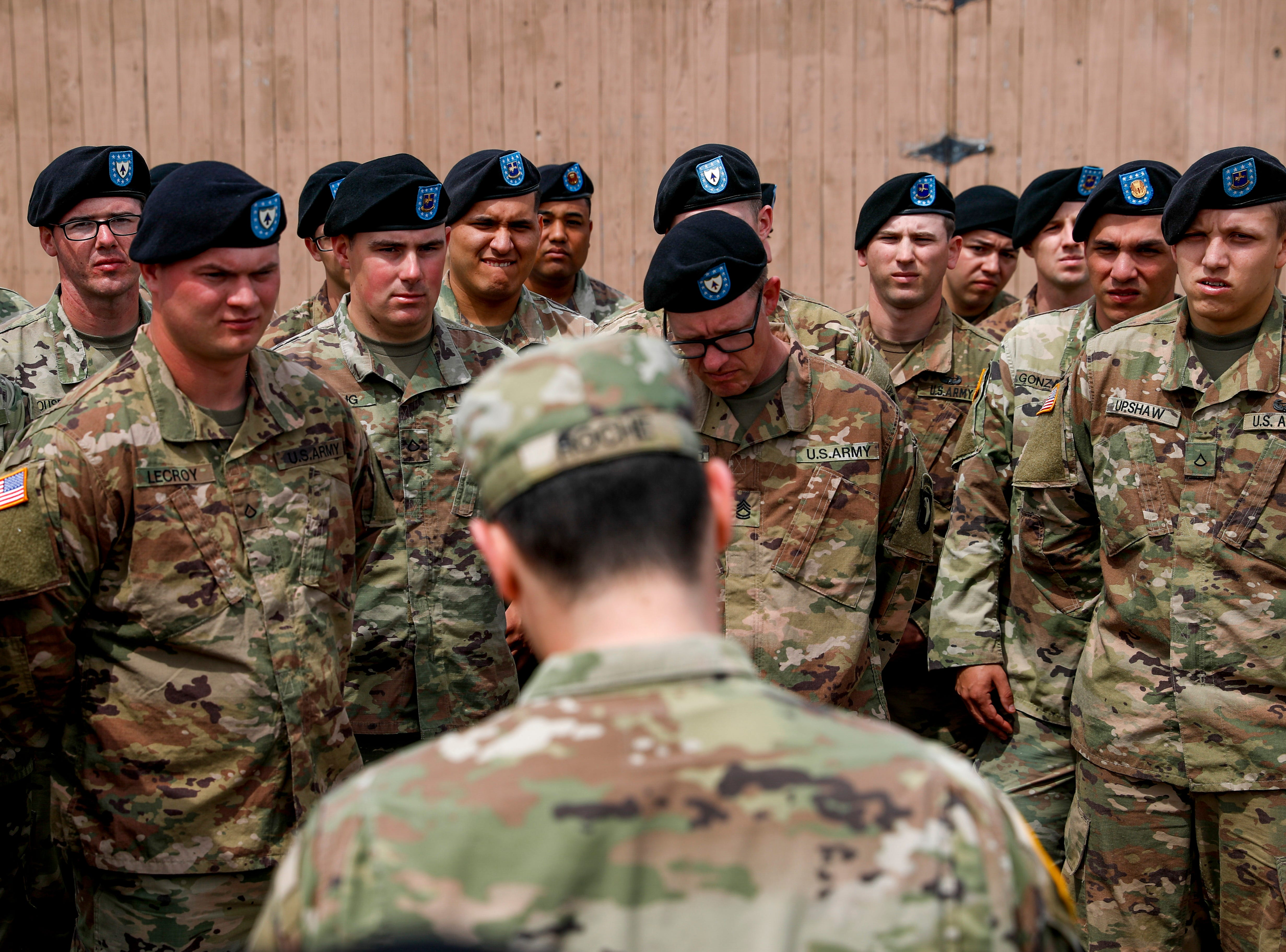 Soldiers listen for their name to be called so they may be dismissed after a colors casing ceremony prior to deployment for Ukraine at 2 BCT Headquarters in Fort Campbell, KY., on Friday, April 12, 2019.