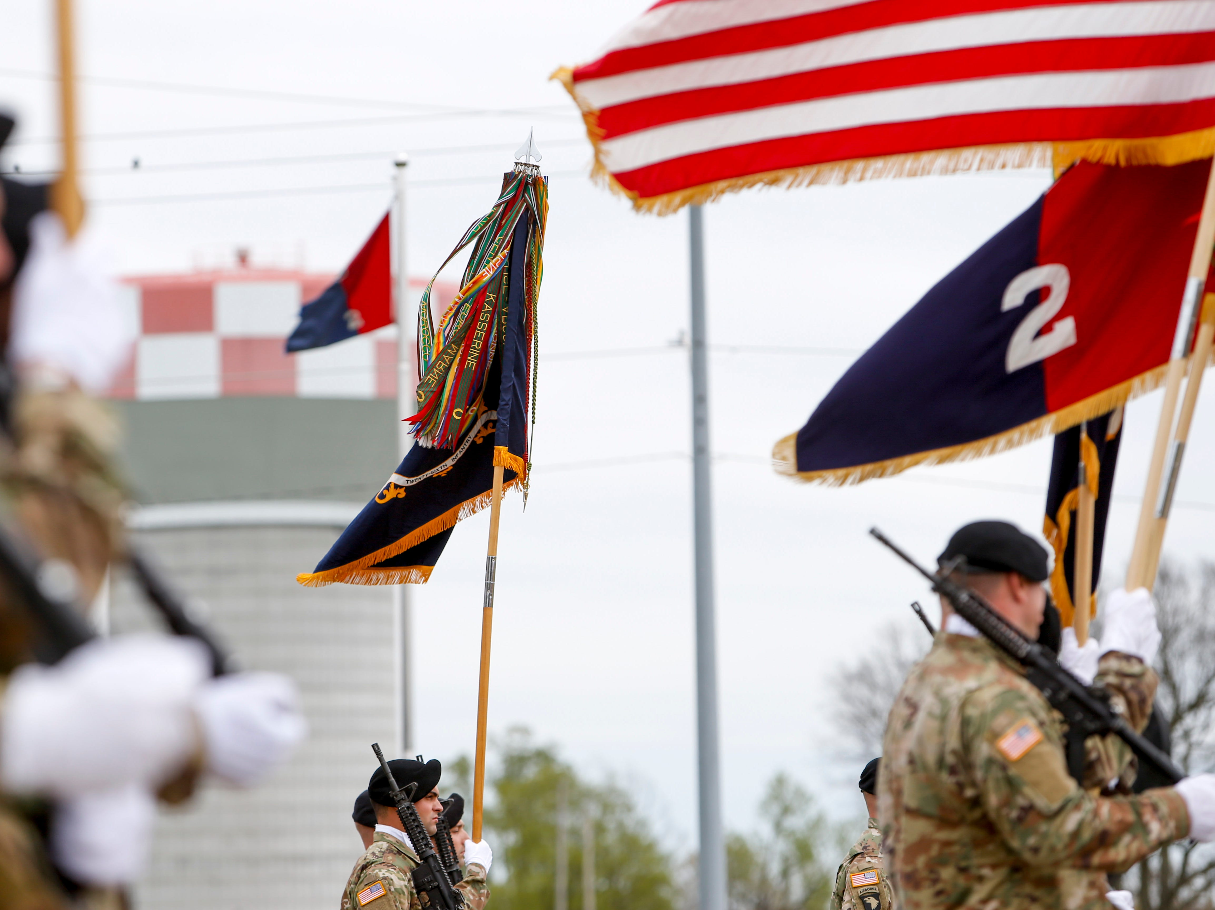 Color guards holding different guidons before the ceremony stand at attention during a colors casing ceremony prior to deployment for Ukraine at 2 BCT Headquarters in Fort Campbell, KY., on Friday, April 12, 2019.