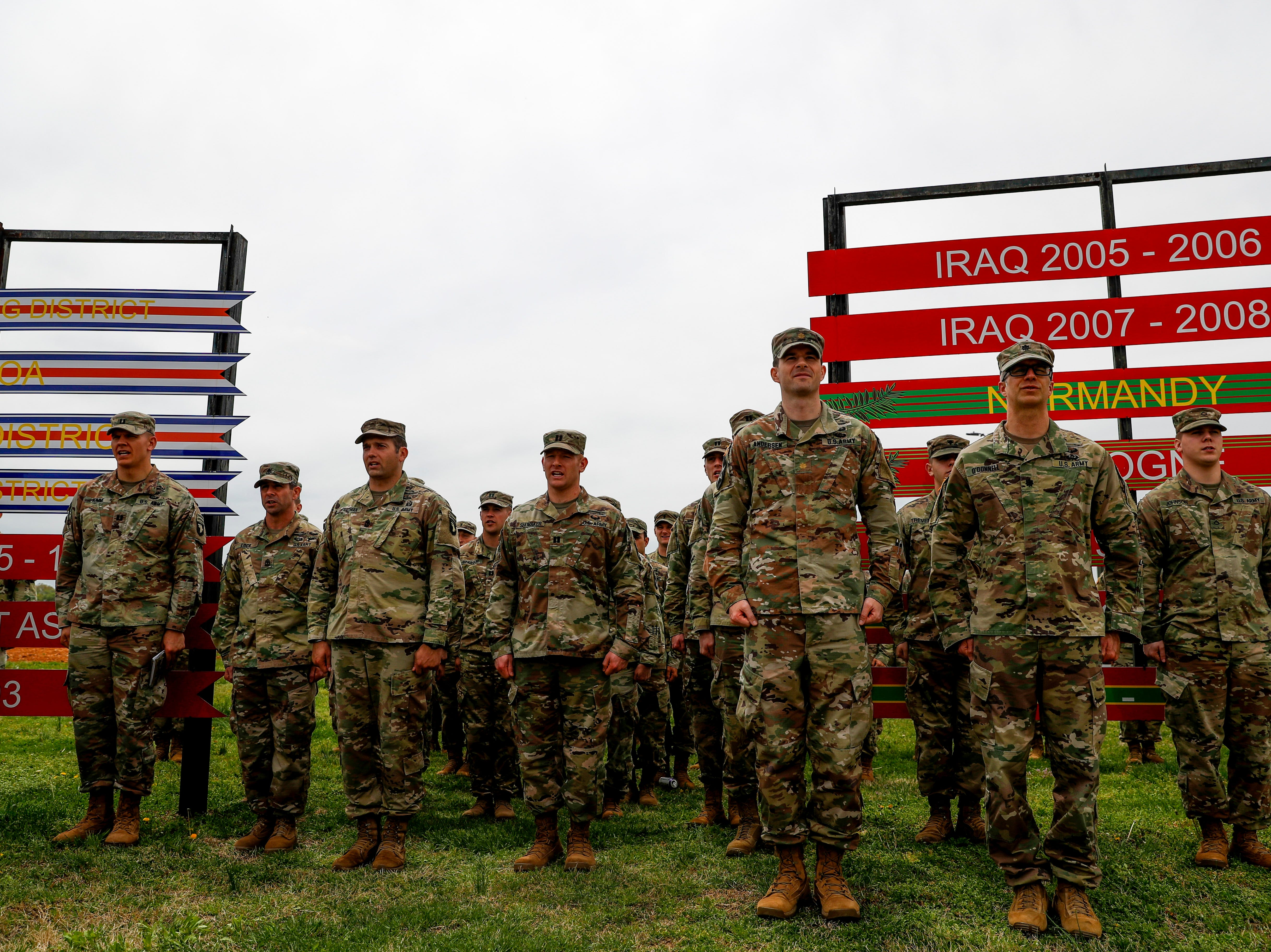 Soldiers stand at attention while watching fellow soldiers during a colors casing ceremony prior to deployment for Ukraine at 2 BCT Headquarters in Fort Campbell, KY., on Friday, April 12, 2019.
