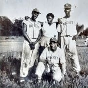 Rockets players Rufus Ramey, kneeling, with Skinny Jackson, right. The other two are unidentified.