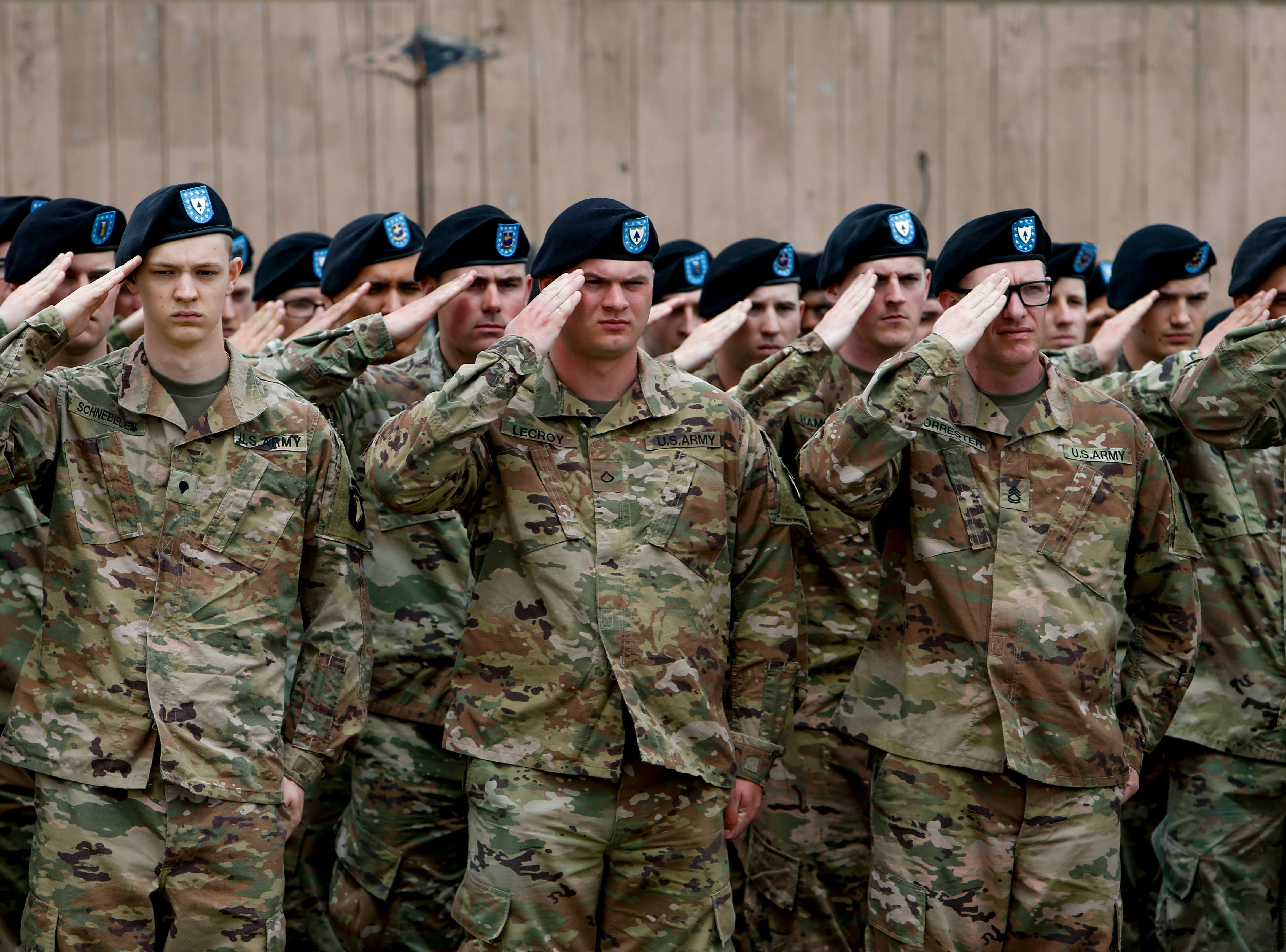 "Soldiers of the 2nd Brigade Combat Team ""Strike,"" 101st Airborne Division (Air Assault) salute during a colors casing ceremony prior to deployment for Ukraine at 2 BCT Headquarters in Fort Campbell, KY., on Friday, April 12, 2019."