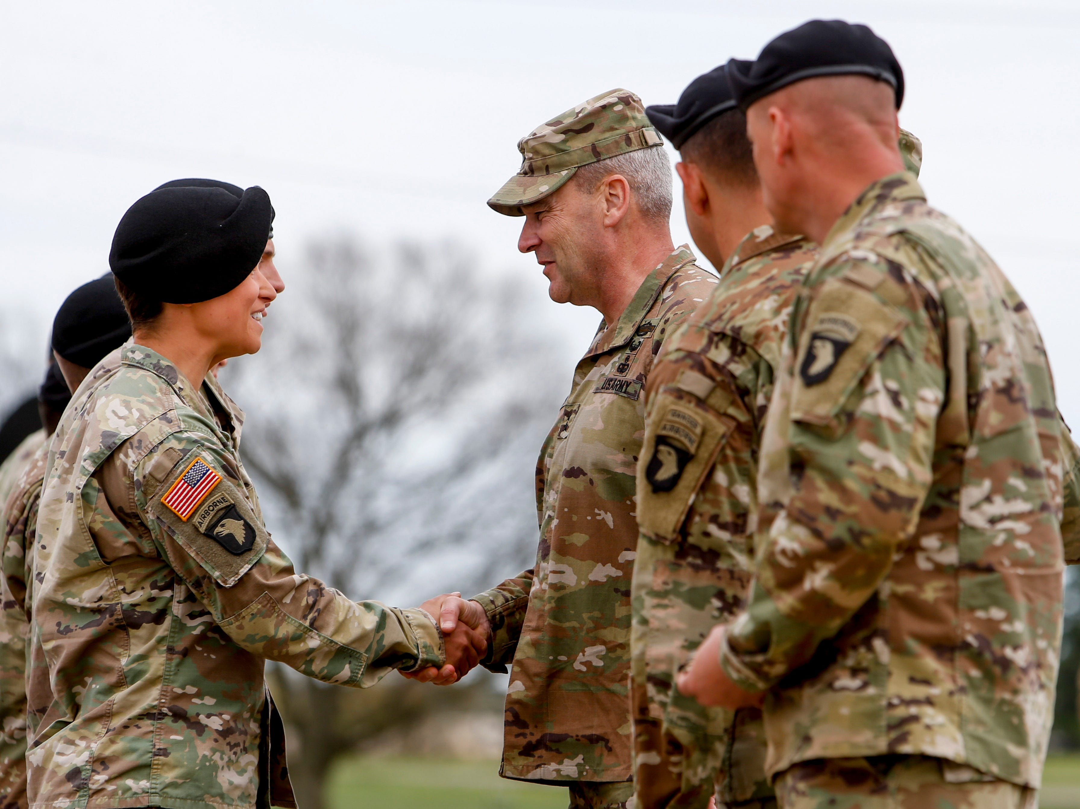 Commander of division Maj. Gen. Brian Winski shakes the hands of soldiers that completed Ranger school during a colors casing ceremony prior to deployment for Ukraine at 2 BCT Headquarters in Fort Campbell, KY., on Friday, April 12, 2019.