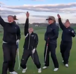 Get in the Masters mood with this perfectly synchronized four-person putt in extremely windy conditions