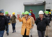 U.S. senator and current Democratic presidential candidate hopeful Amy Klobuchar talks with Chris Cleveland, left, product manager at Lincoln Way Energy, and president Mike Hollenberg during a tour of the plant in Nevada on Friday, April 12, 2019.
