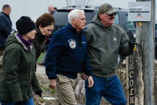 Vice President Mike Pence meets with Sen. Joni Ernst, left, Gov. Kim Reynolds, second from left, and farmer Dennis Lincoln to tour tour flood damage at LincolnÕs Ridgeview Farms on Friday, April 12, 2019, in Pacific Junction.