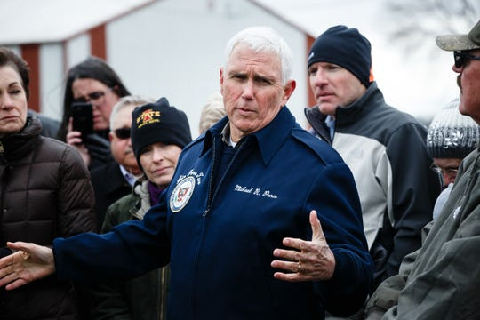 Vice President Mike Pence addresses the press and other locals after touring flood damage at LincolnÕs Ridgeview Farms on Friday, April 12, 2019, in Pacific Junction.