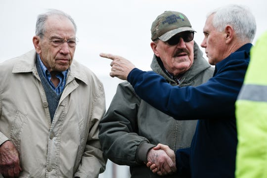 Vice President Mike Pence shakes hands with farmer Dennis Lincoln as they tour flood damage with Sen. Chuck Grassley and other Iowa political leaders at Lincoln Ridgeview Farms on Friday, April 12, 2019, in Pacific Junction.