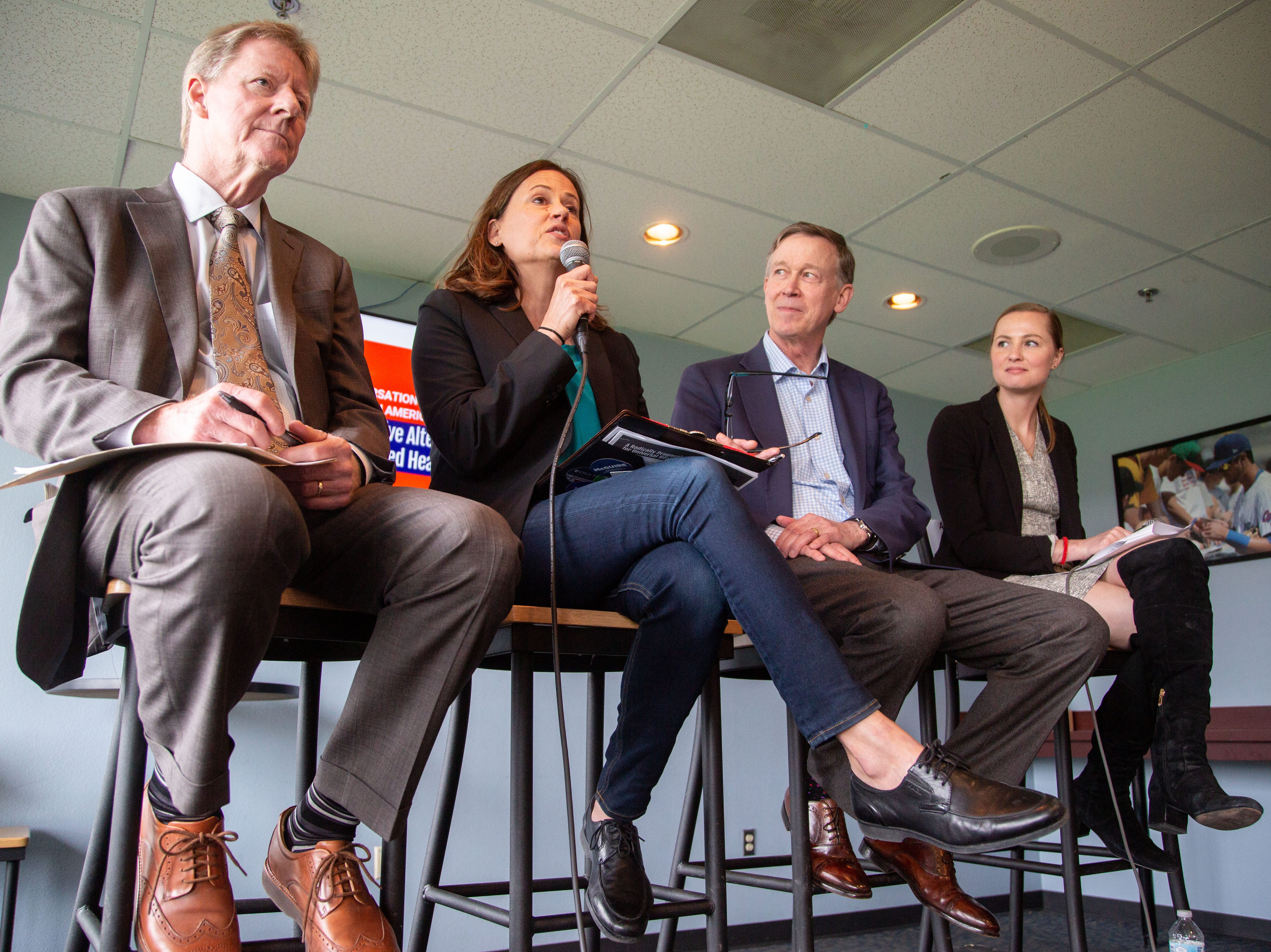 Will Marshall, Theresa Greenfield, Governor John Hickenlooper and Arielle Kane take part in a discussion on alternatives to nationalized health care hosted by the Progressive Policy Institute at the Cub Club Friday, April 12, 2019.
