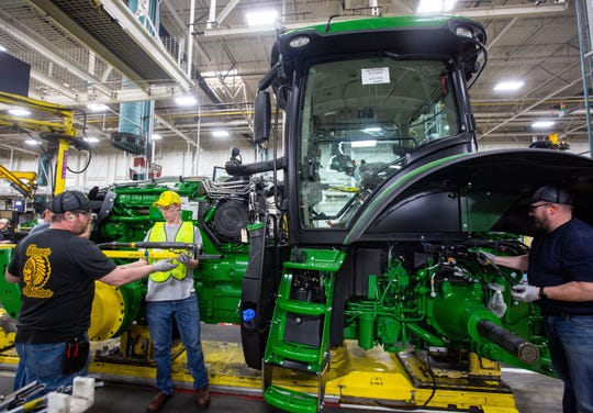 "Tate Van Regenmorter, 15, uses a suspended hydraulic tool to at attach a bolt during a ""gold key tour"" at John Deere's Waterloo assembly plant Tuesday, April 9, 2019."