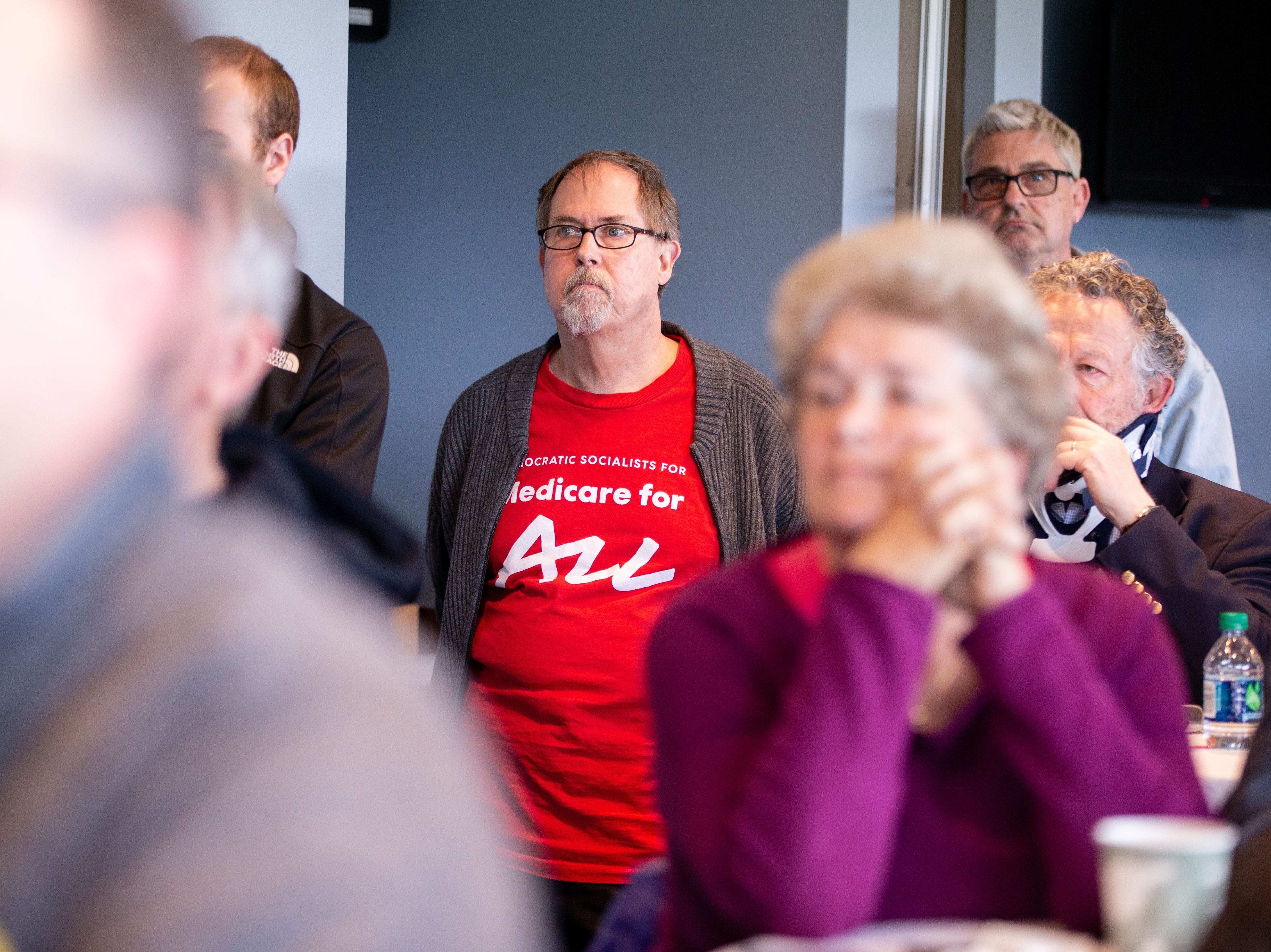 Medicare for a supporter Michael McKinley attends  a discussion on alternatives to nationalized health care hosted by the Progressive Policy Institute at the Cub Club Friday, April 12, 2019.