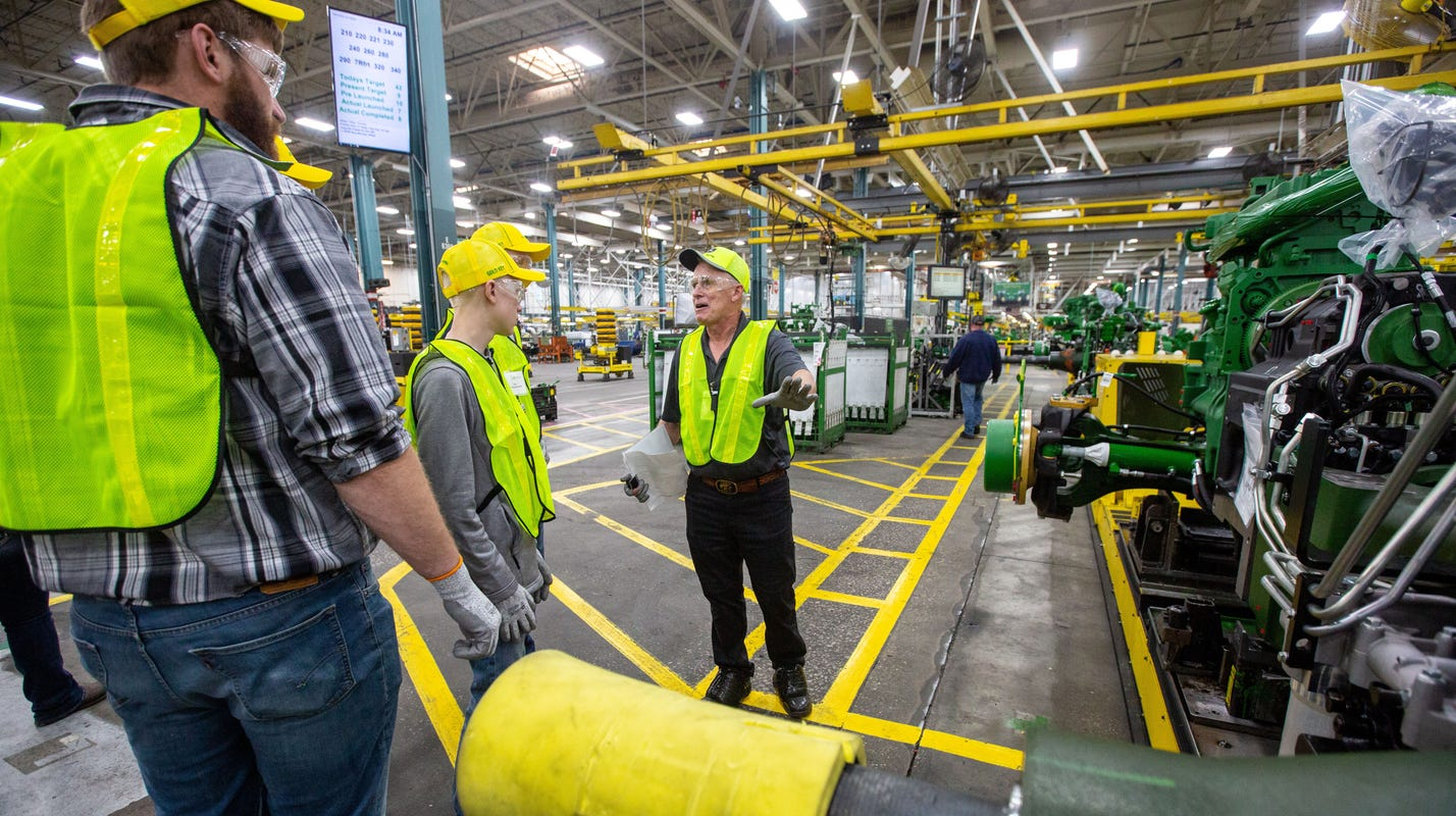 Deere cuts 57 employees at its Davenport plant, projecting reduced construction activity next year