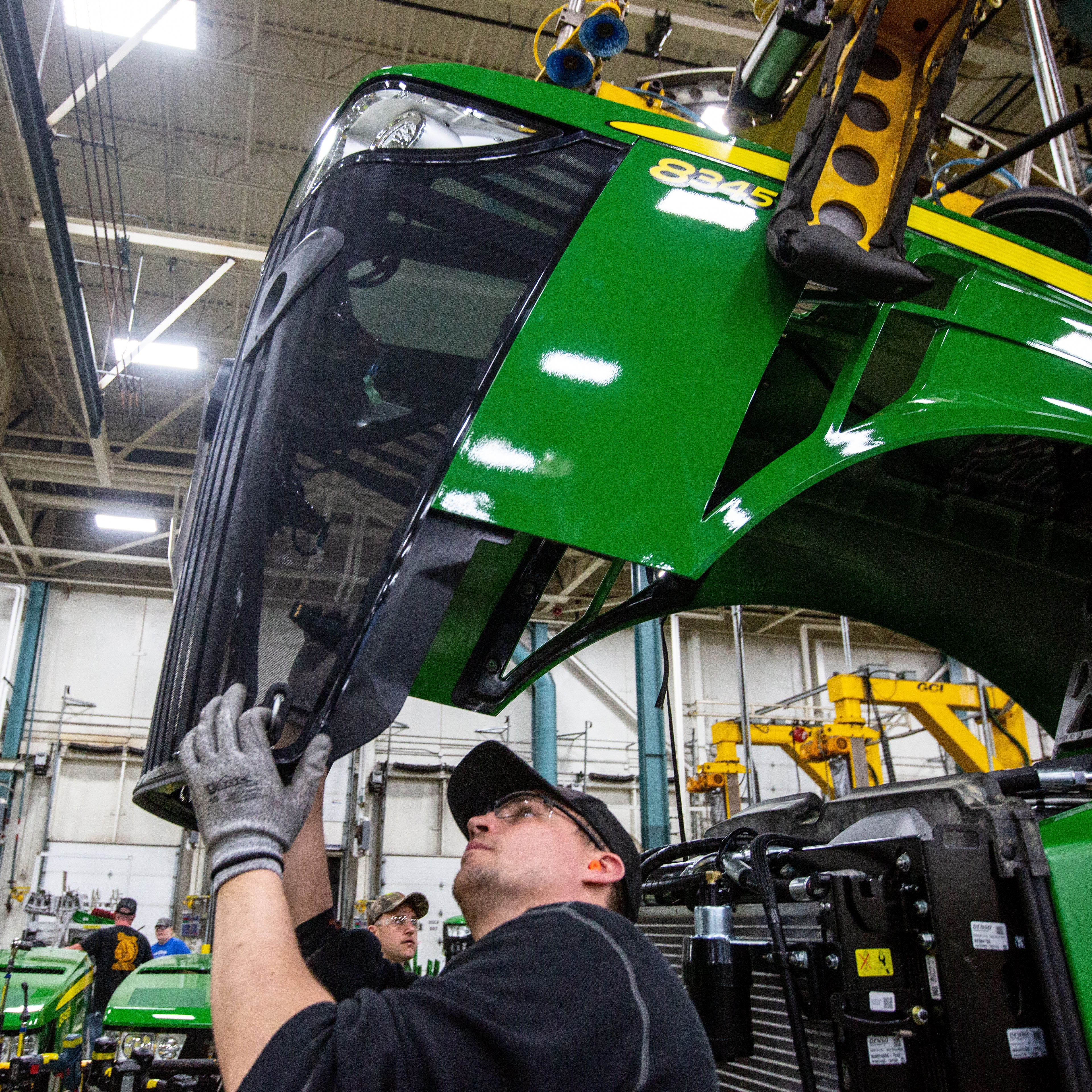Like Iowa farmers, John Deere tries to power through ag industry downturn
