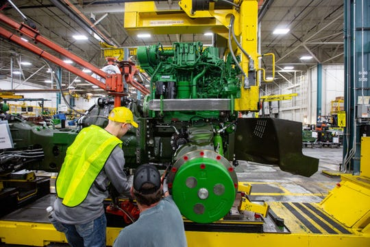 "Kaden Van Regenmorter, 13, uses a suspended hydraulic tool to at attach a bolt during a ""gold key tour"" at John Deere's Waterloo assembly plant Tuesday, April 9, 2019."