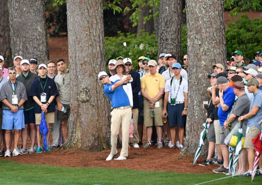 Apr 12, 2019; Augusta, GA, USA; Zach Johnson hits from the pine straw on the 2nd hole during the second round of The Masters golf tournament at Augusta National Golf Club.