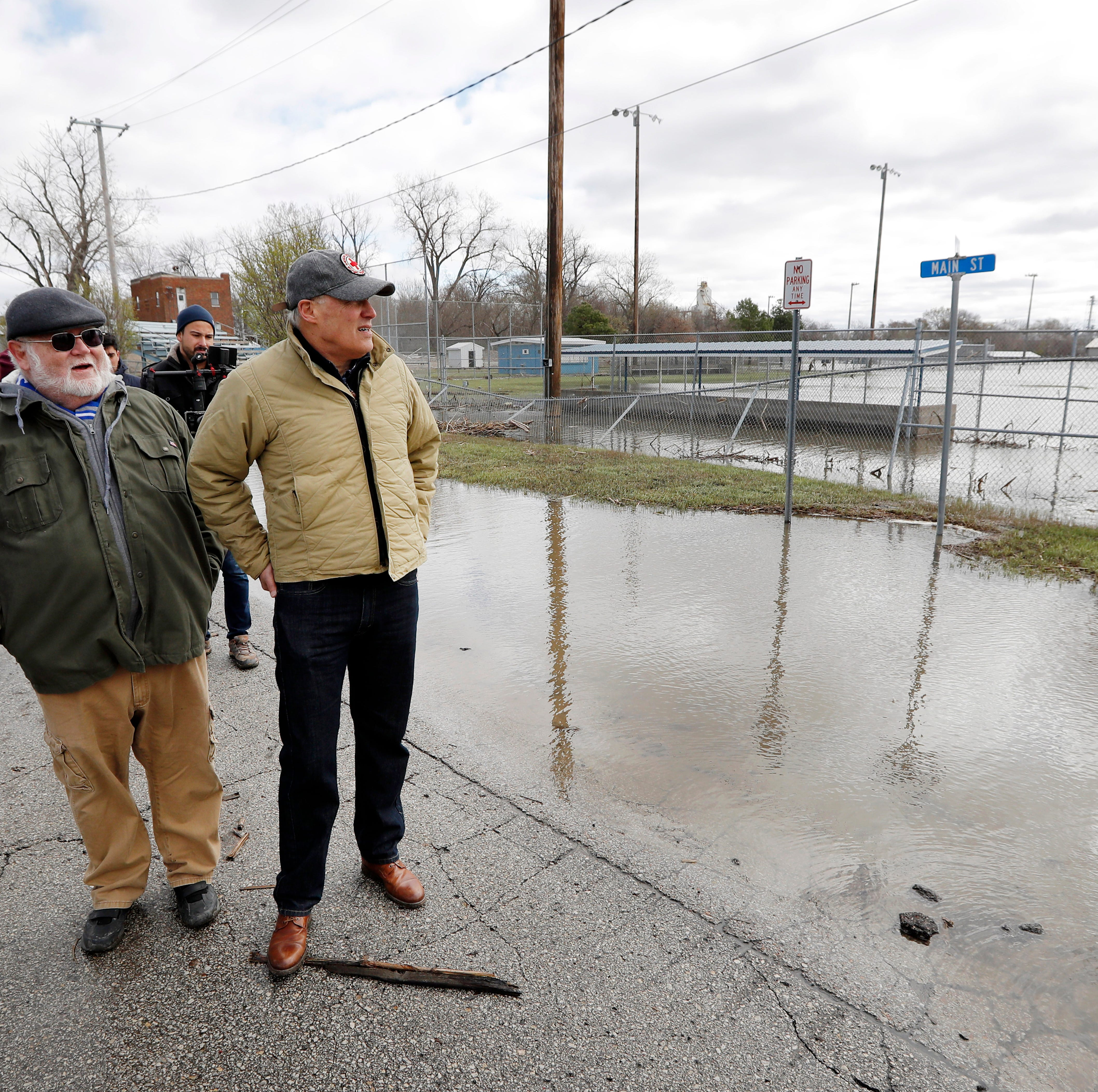 Jay Inslee believes climate change intensified flooding in Hamburg. Some residents say no.