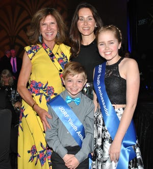 Cynthia Ford, James Taylor, Nikki Borges and Addison Meadows, left to right, at the at 2018 Juvenile Diabetes Research Foundation Promise Ball at MGM Detroit in May 2018.