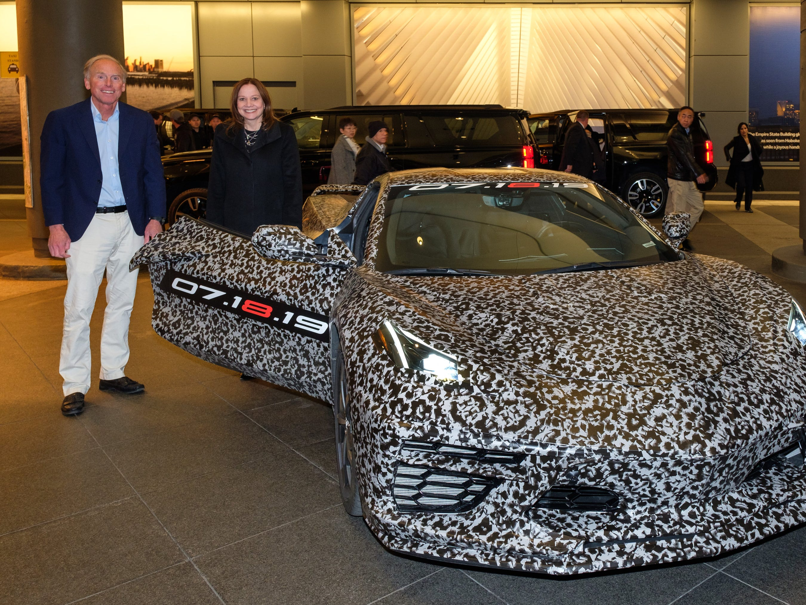 Chevrolet Corvette Chief Engineer Tadge Juechter and General Motors Chairman and CEO Mary Barra Thursday, April 11, 2019 with a camouflaged next generation Corvette near Times Square in New York, New York. The next generation Corvette will be unveiled on July 18. (Photo by Steve Fecht for Chevrolet)