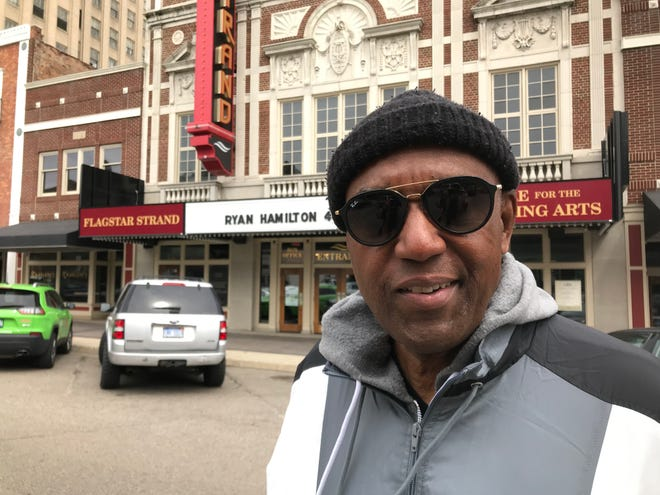 Walter Moore, former Pontiac mayor, smiles in the city's downtown on April 11, 2019 after discussing the city pension fund's fateful investment in Walmart.